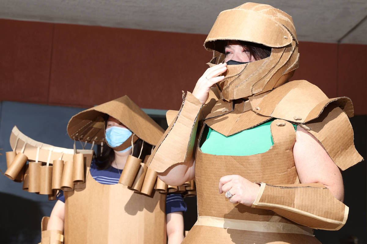 Jessica Yi, left, and Anne Savage, model their cardboard costumes during their class at UNLV in ...