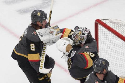 Vegas Golden Knights goalie Robin Lehner (90) makes a save as Zach Whitecloud (2) defends durin ...