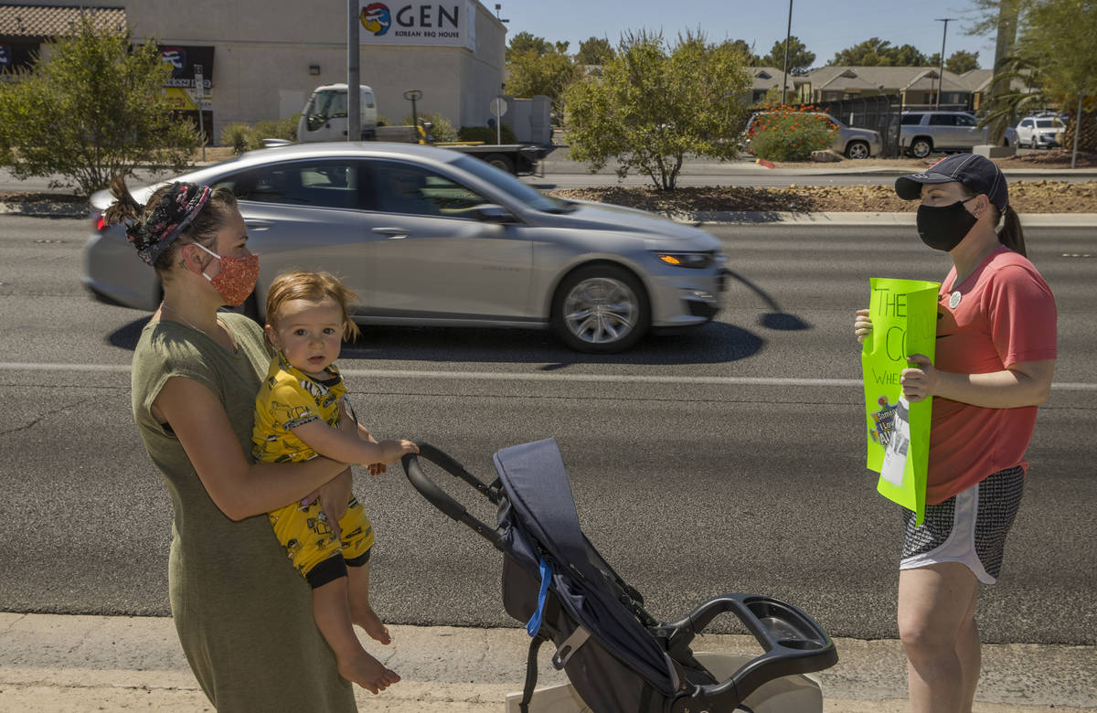 Esther Johnson, left, with son Eli Yosef, 1, stand with Diana Battista outside the County Schoo ...