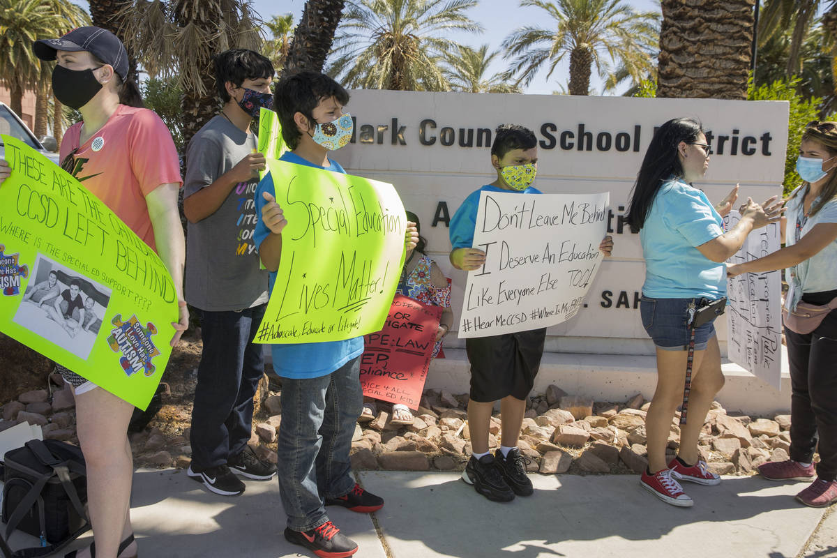 Clark County School District parents and students stand outside the administration center to pr ...