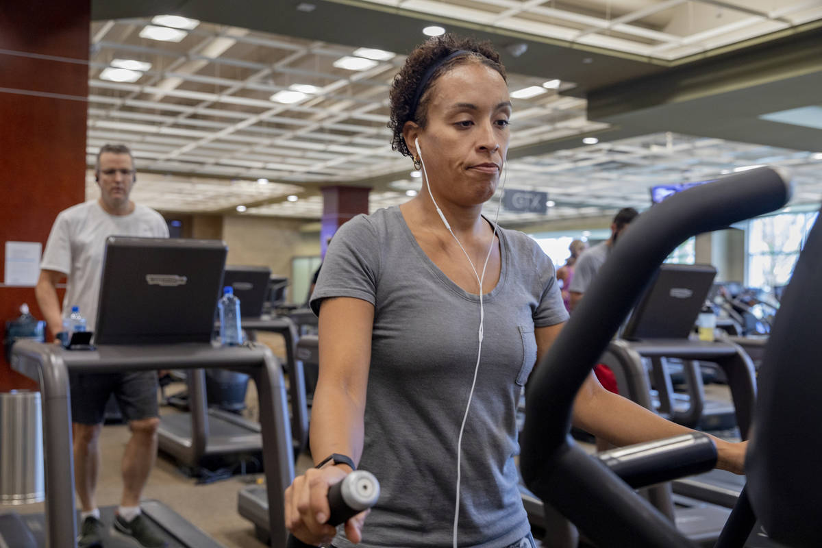 Life Time Fitness member Keri Mladenov of Las Vegas uses a treadmill at the Life Time Fitness ...