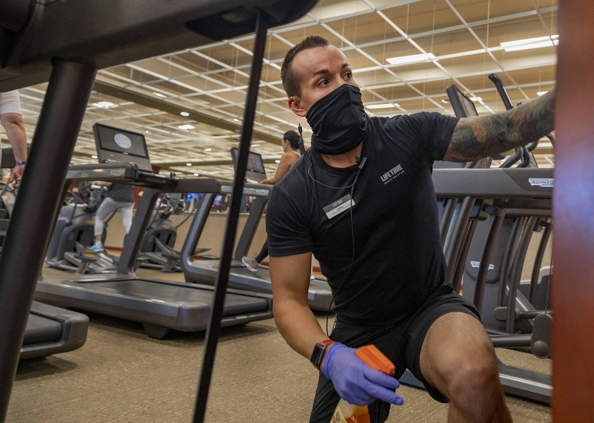 Life Time Fitness facility operations team member Jonathan Palmer deep cleans the Henderson loc ...