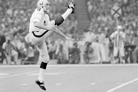 Oakland Raiders punter, Ray Guy, is pictured kicking during the Super Bowl at the Superdome in ...