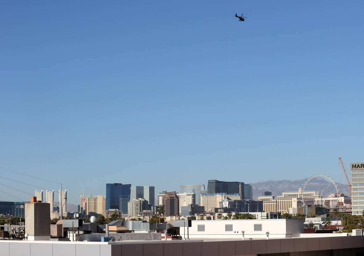 Las Vegas Review-Journal columnist John Katsilometes and Piff the Magic Dragon fly in a helicop ...