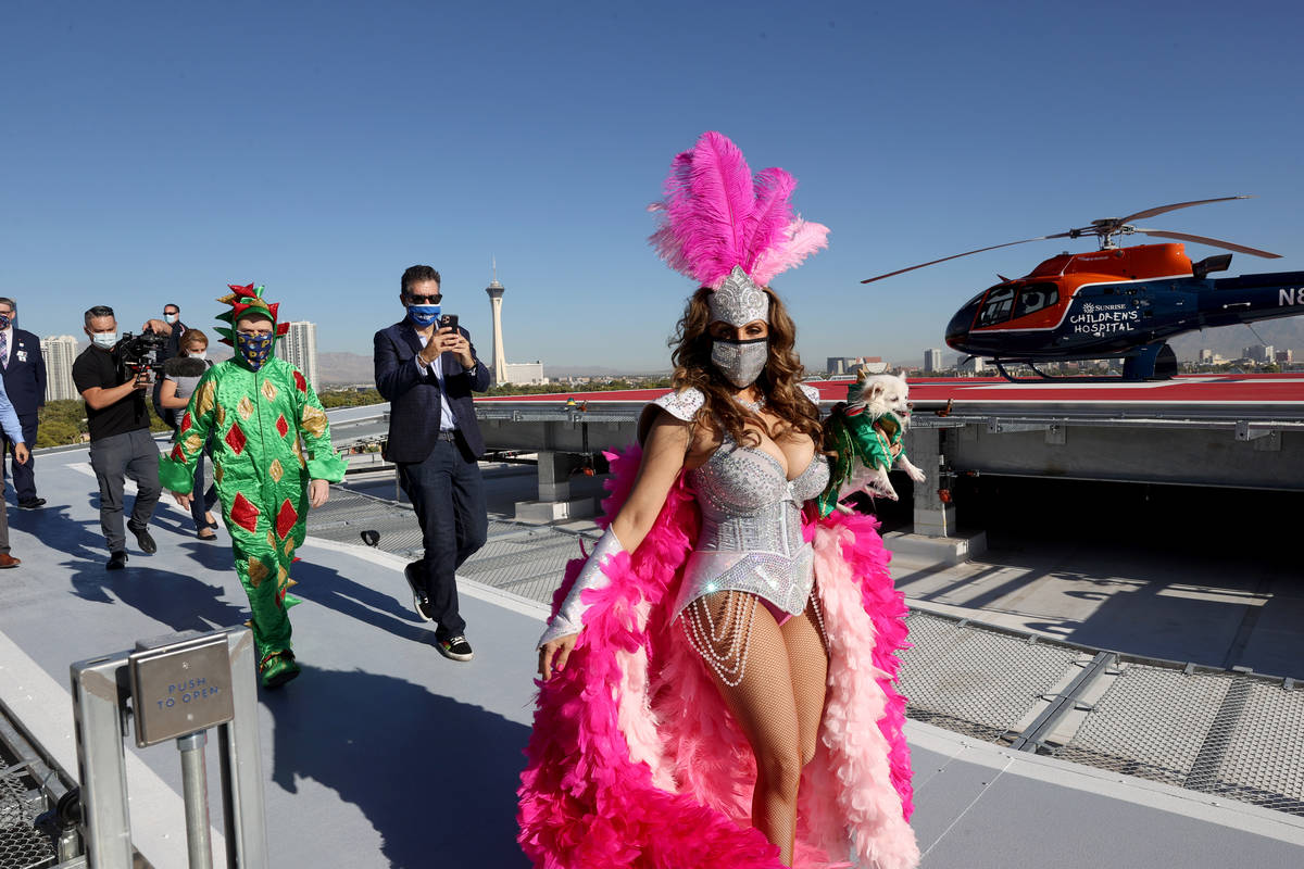 Jade Simone, Mr Piffles, Las Vegas Review-Journal columnist John Katsilometes and Piff the Magi ...