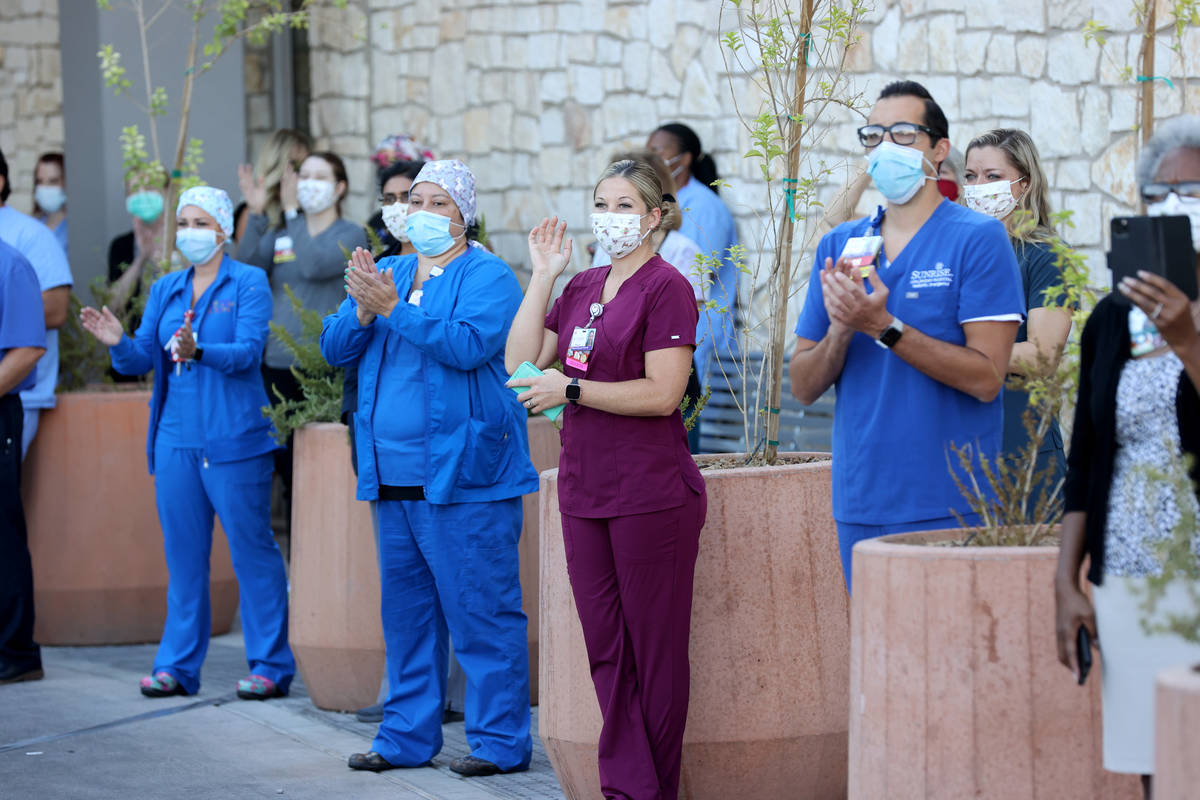 Medical professionals at Sunrise Hospital and Medical Center in Las Vegas, watch a #MaskUpNV sh ...