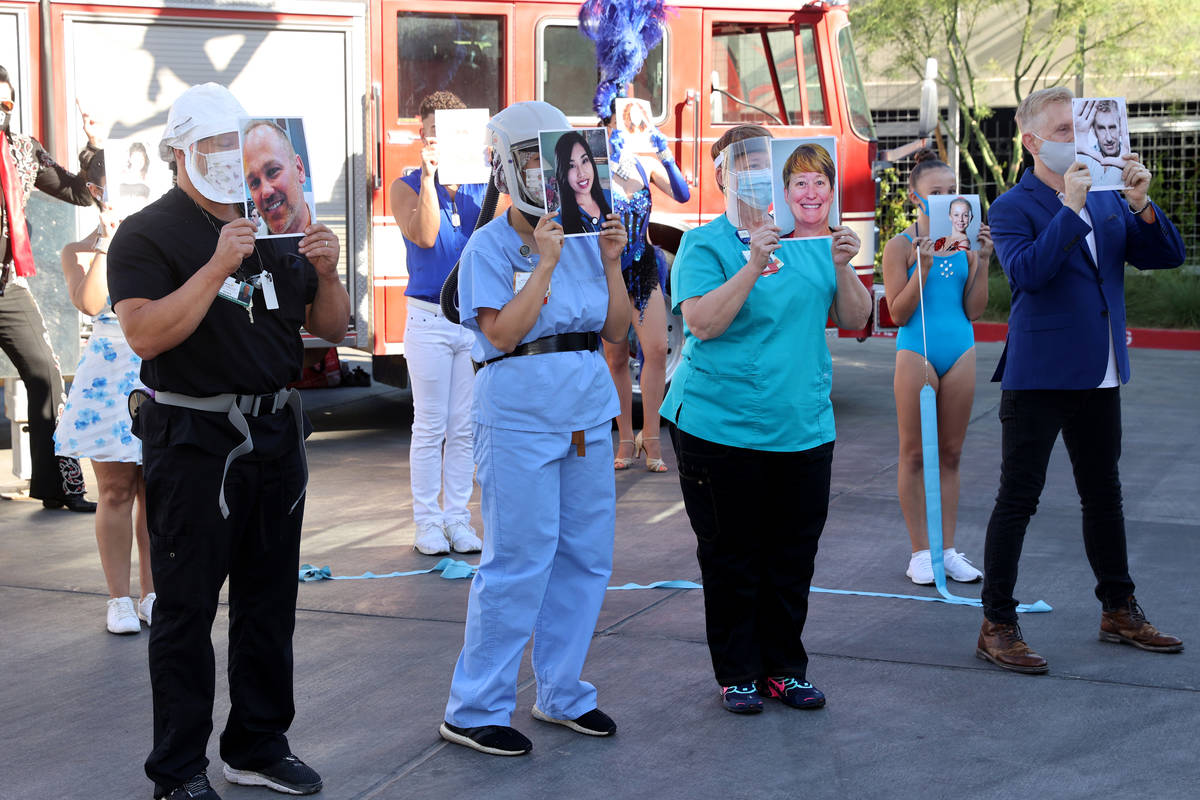Entertainers and medical professionals, including from left, Aaron Huttenlocker, team superviso ...