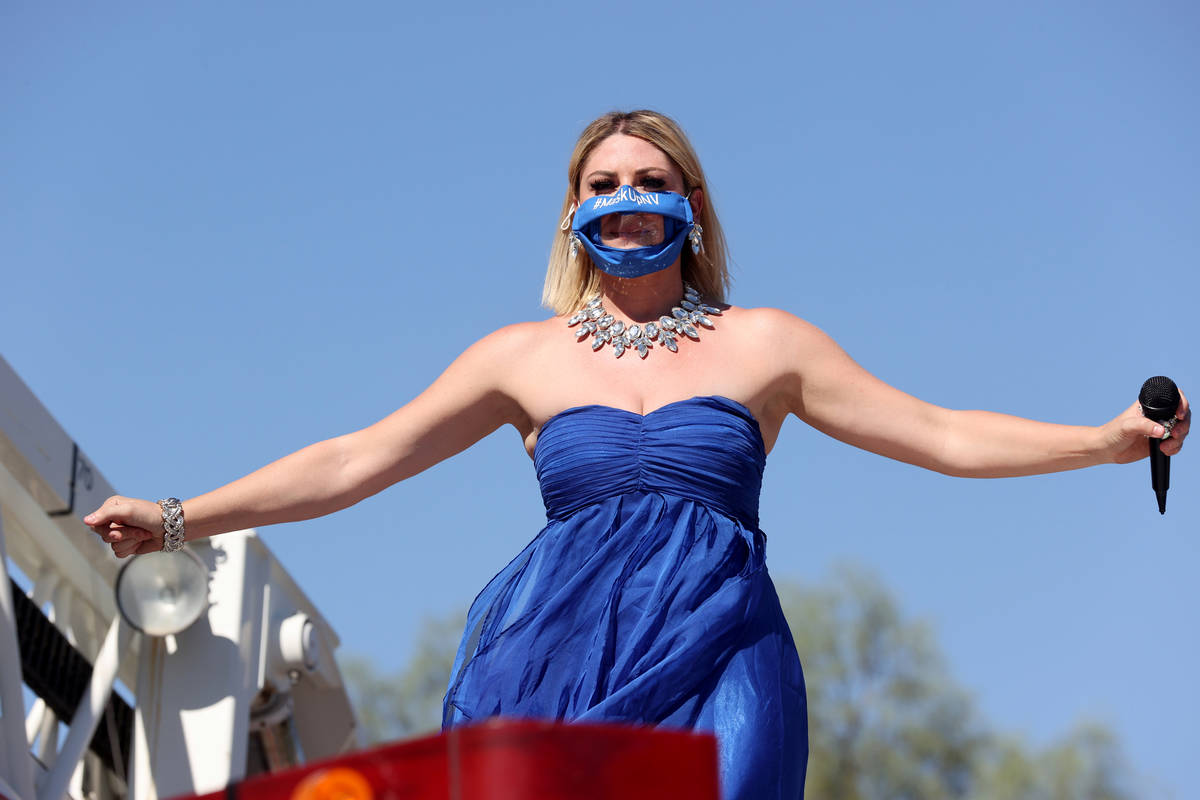 Singer Emily Yates performs on a fire truck during a show for medical professionals at Valley H ...