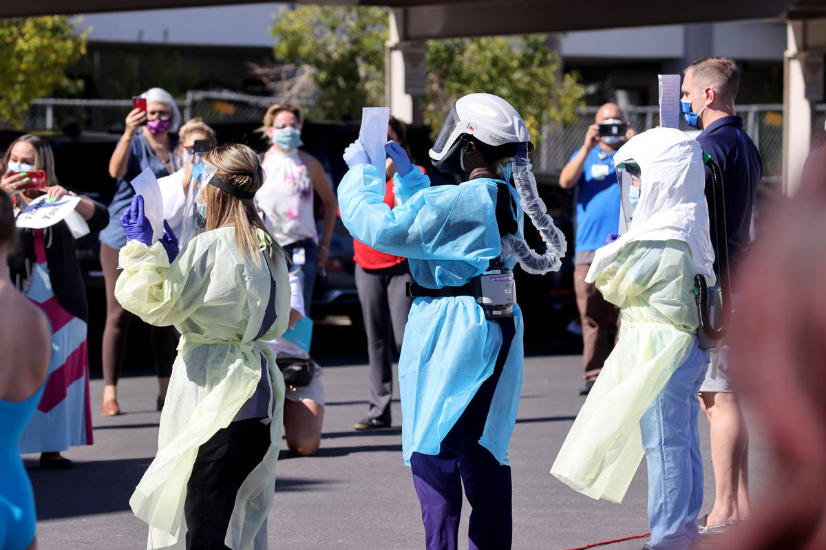 Medical professionals at Valley Hospital Medical Center in Las Vegas, during a #MaskUpNV show a ...
