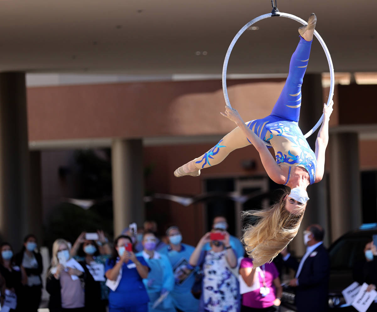 Aerialist Alyssa McCraw performs a #MaskUpNV show for medical professionals at Spring Valley Ho ...