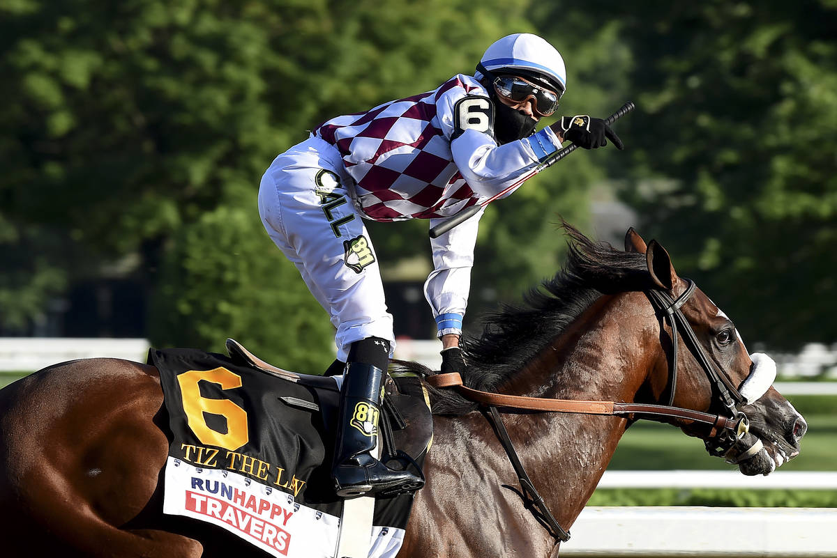 In a photo provided by the NYRA, jockey Manny Franco reacts after crossing the finish line with ...