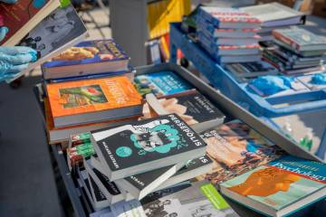 Spring Valley High School staff organizes returned text books from students while the school st ...