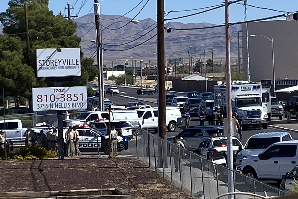 Police investigate a shooting Monday, Aug. 10, 2020, on the 3700 block of North Nellis Boulevar ...