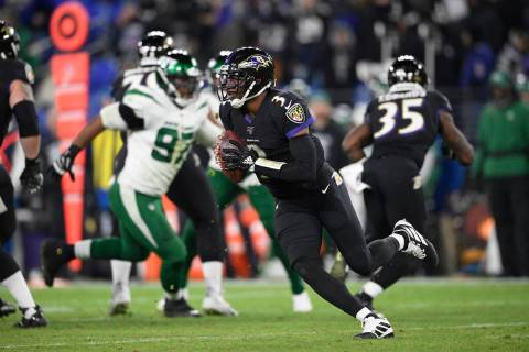 Baltimore Ravens quarterback Robert Griffin III (3) scrambles during the second half of an NFL ...