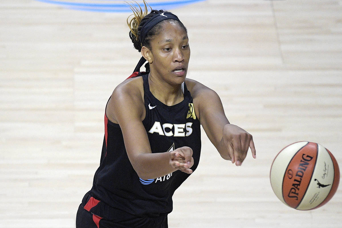 Las Vegas Aces forward A'ja Wilson (22) passes the ball during the second half of a WNBA basket ...