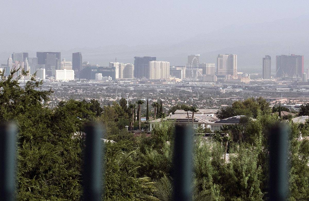 A haze hangs over the Strip as seen from Henderson on Thursday, Aug. 13, 2020, in Las Vegas. Cl ...