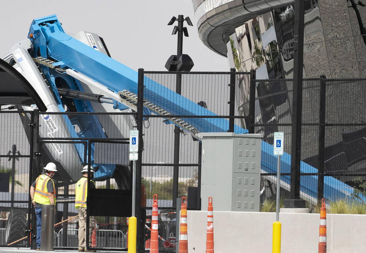A boom lift lays on its side on the exterior of Allegiant Stadium in Las Vegas on Thursday, Aug ...