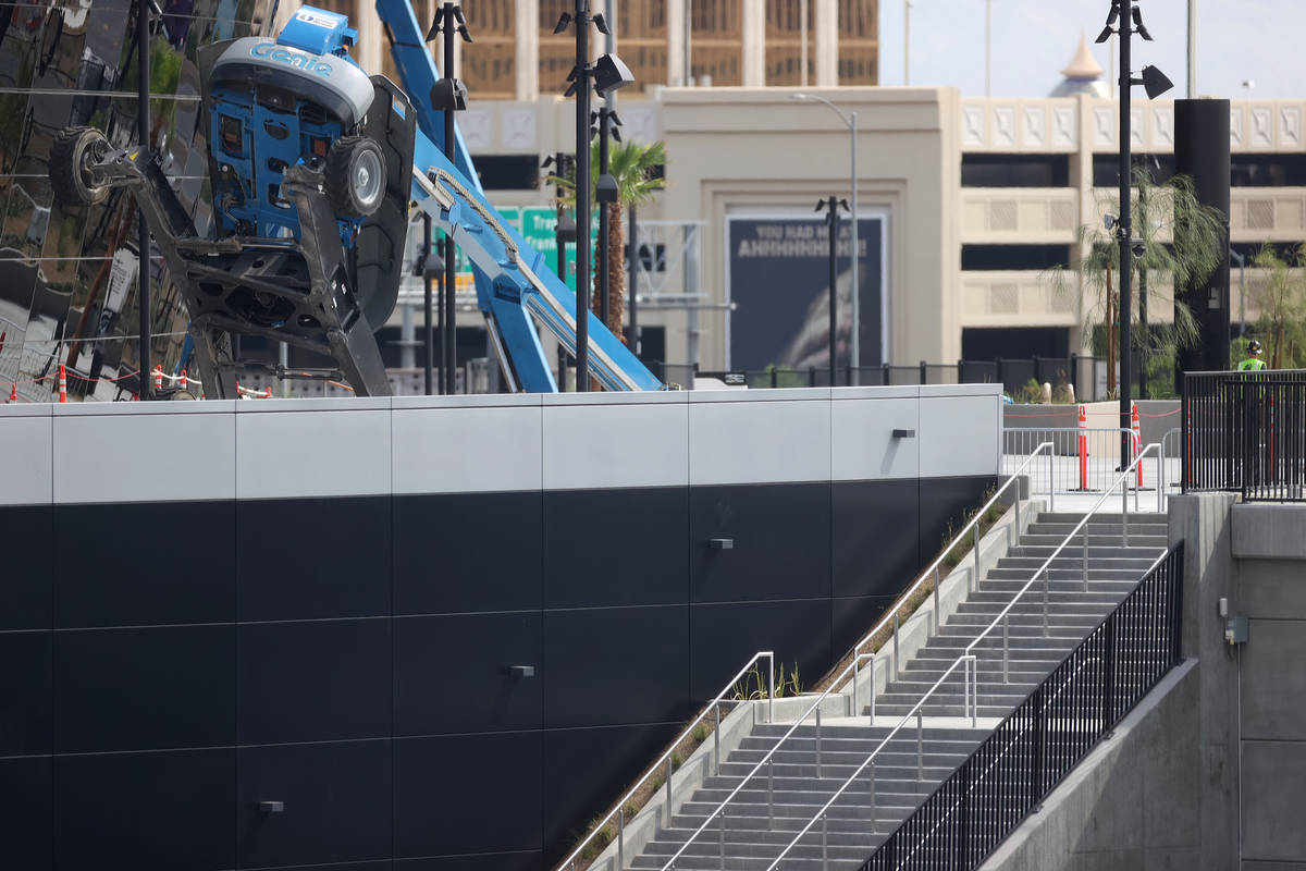 A boom lift lays on its side on the exterior of Allegiant Stadium in Las Vegas, Thursday, Aug. ...