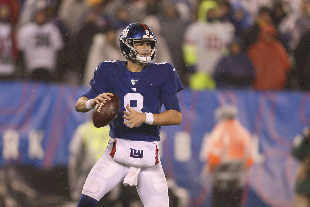 FILE - In this Dec. 29, 2019, file photo, New York Giants quarterback Daniel Jones (8) looks to ...