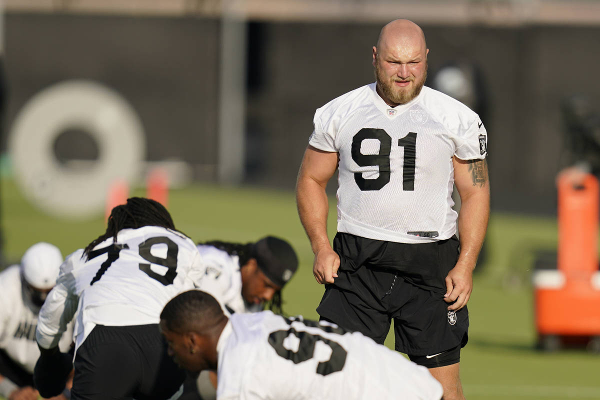 Las Vegas Raiders defensive tackle Mike Panasiuk (91) stretches during an NFL football training ...