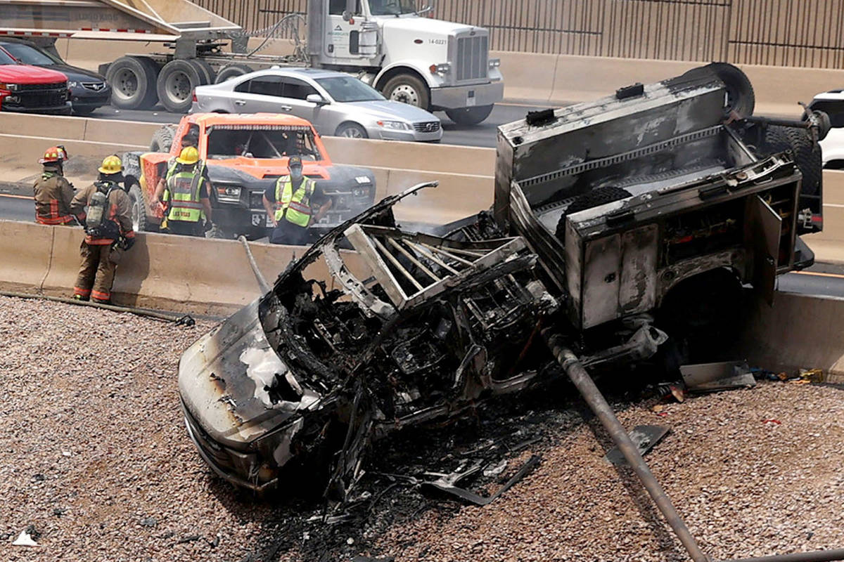 A vehicle fire on I-15 North near the Martin Luther King Boulevard in Las Vegas, Thursday, Aug. ...