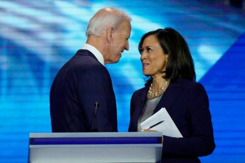 Joe Biden and Sen. Kamala Harris, D-Calif., shake hands after a Democratic presidential primary ...