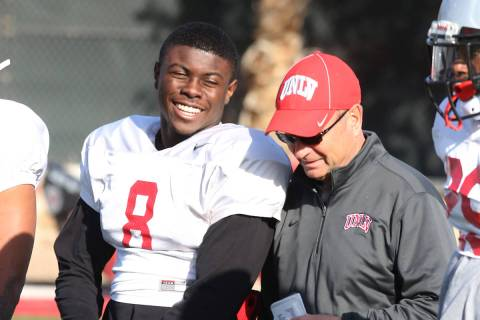 UNLV running back Charles Williams (8) chats with UNLV's Director of Athletic Training Kyle Wil ...