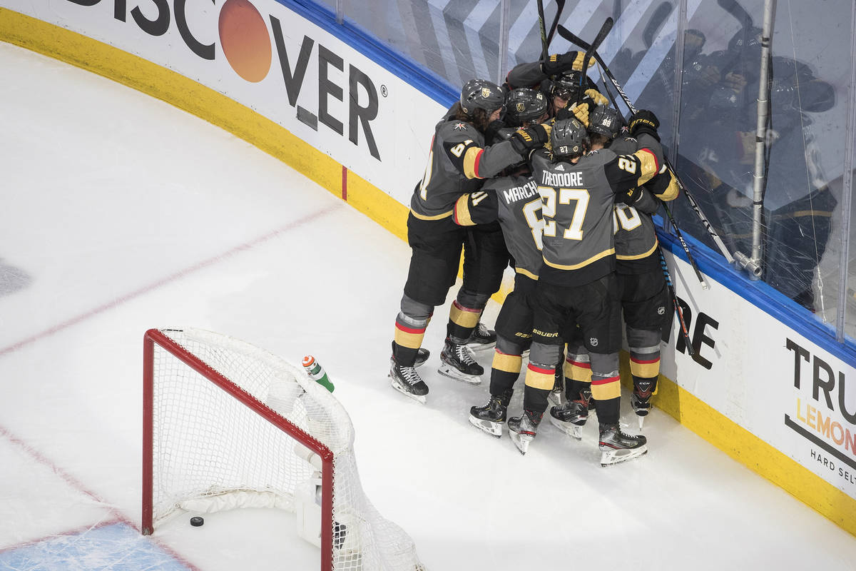 Vegas Golden Knights players celebrate the win over the Chicago Blackhawks after an NHL hockey ...