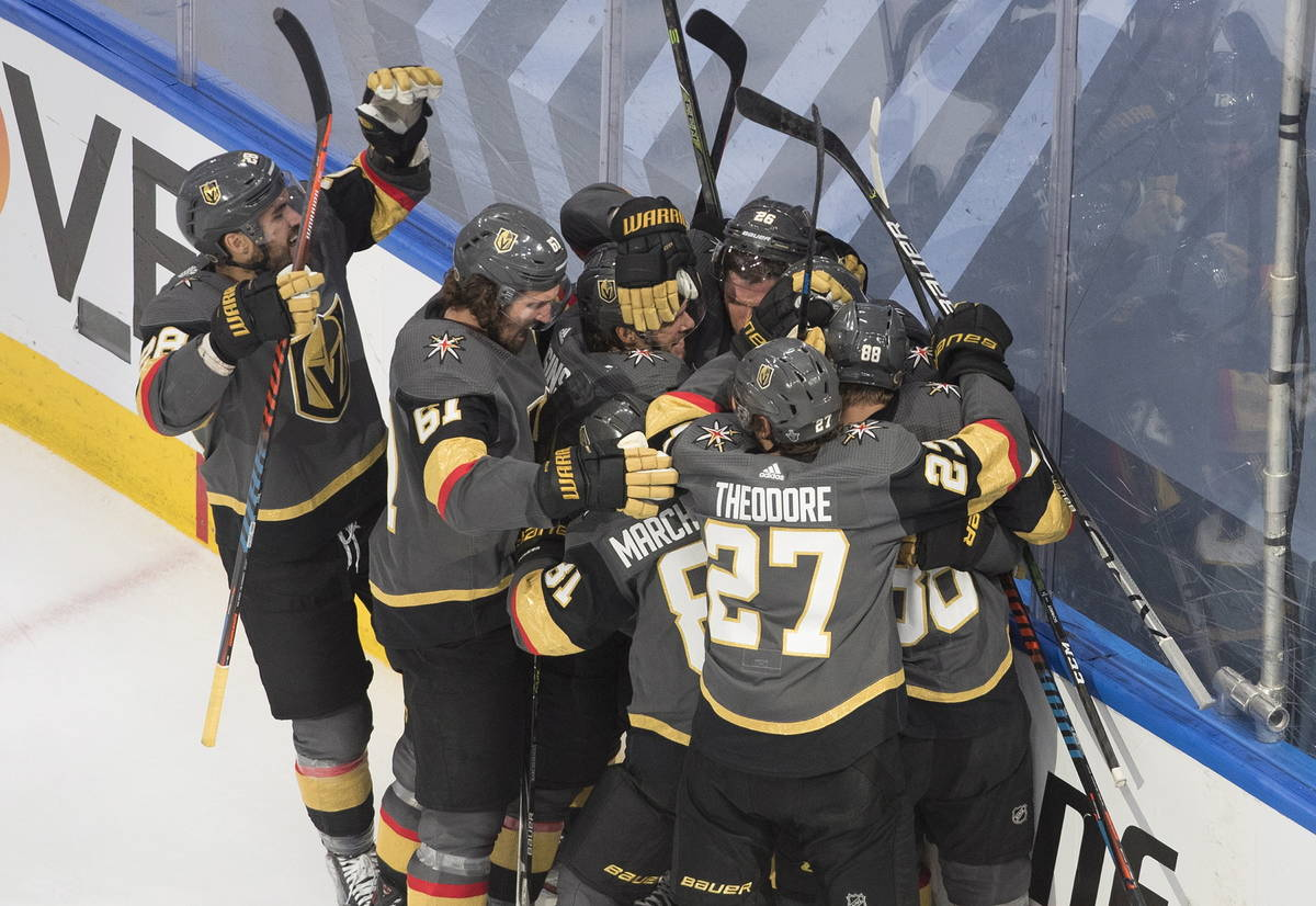 Vegas Golden Knights players celebrate their win over the Chicago Blackhawks after an NHL hocke ...