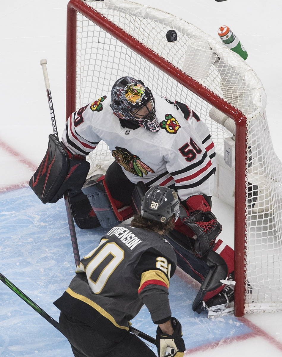 Vegas Golden Knights' Chandler Stephenson (20) watches the puck roll over the net as Chicago Bl ...