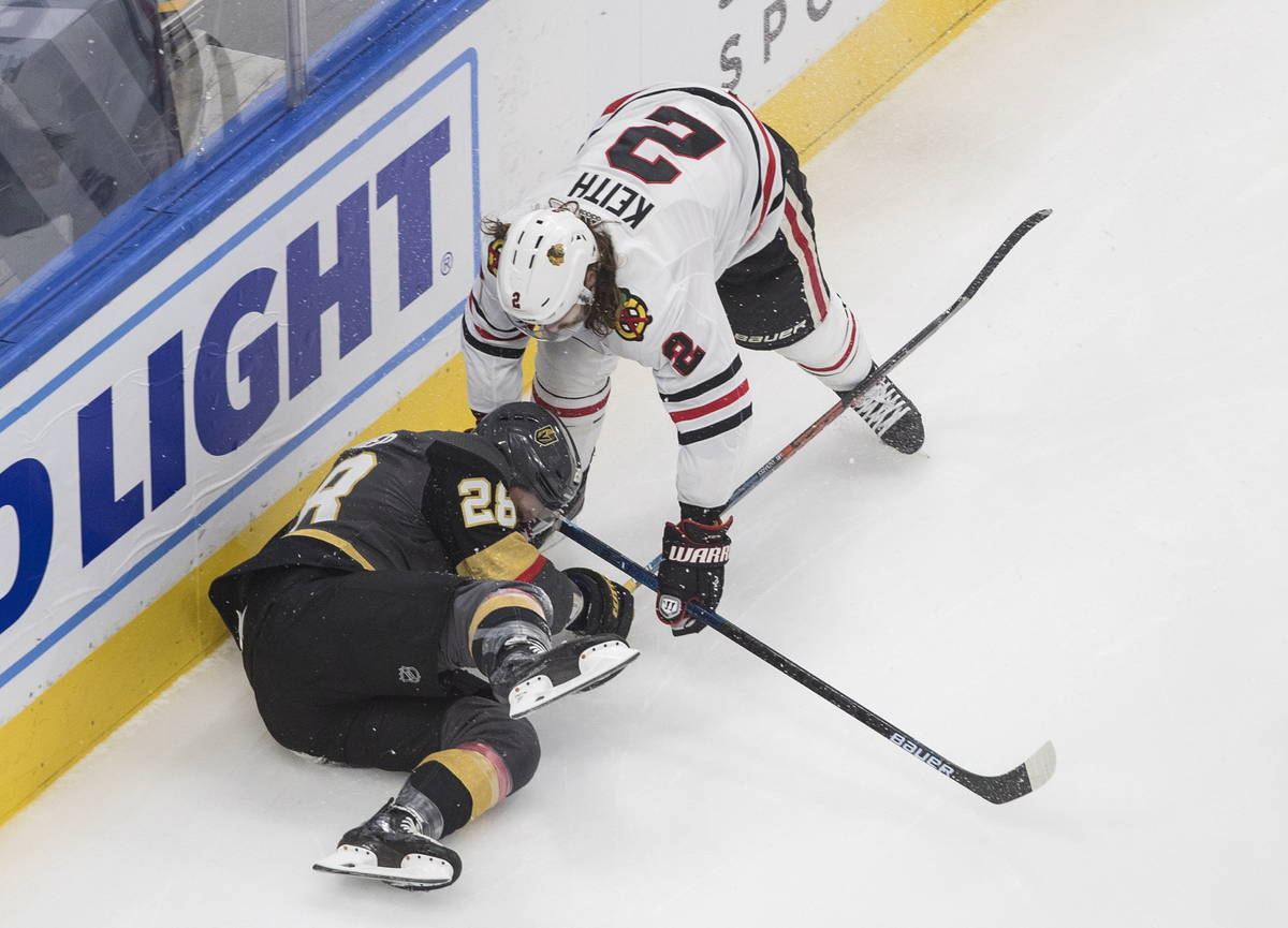 Vegas Golden Knights' Paul Stastny (26) is checked by Chicago Blackhawks' Duncan Keith (2) duri ...