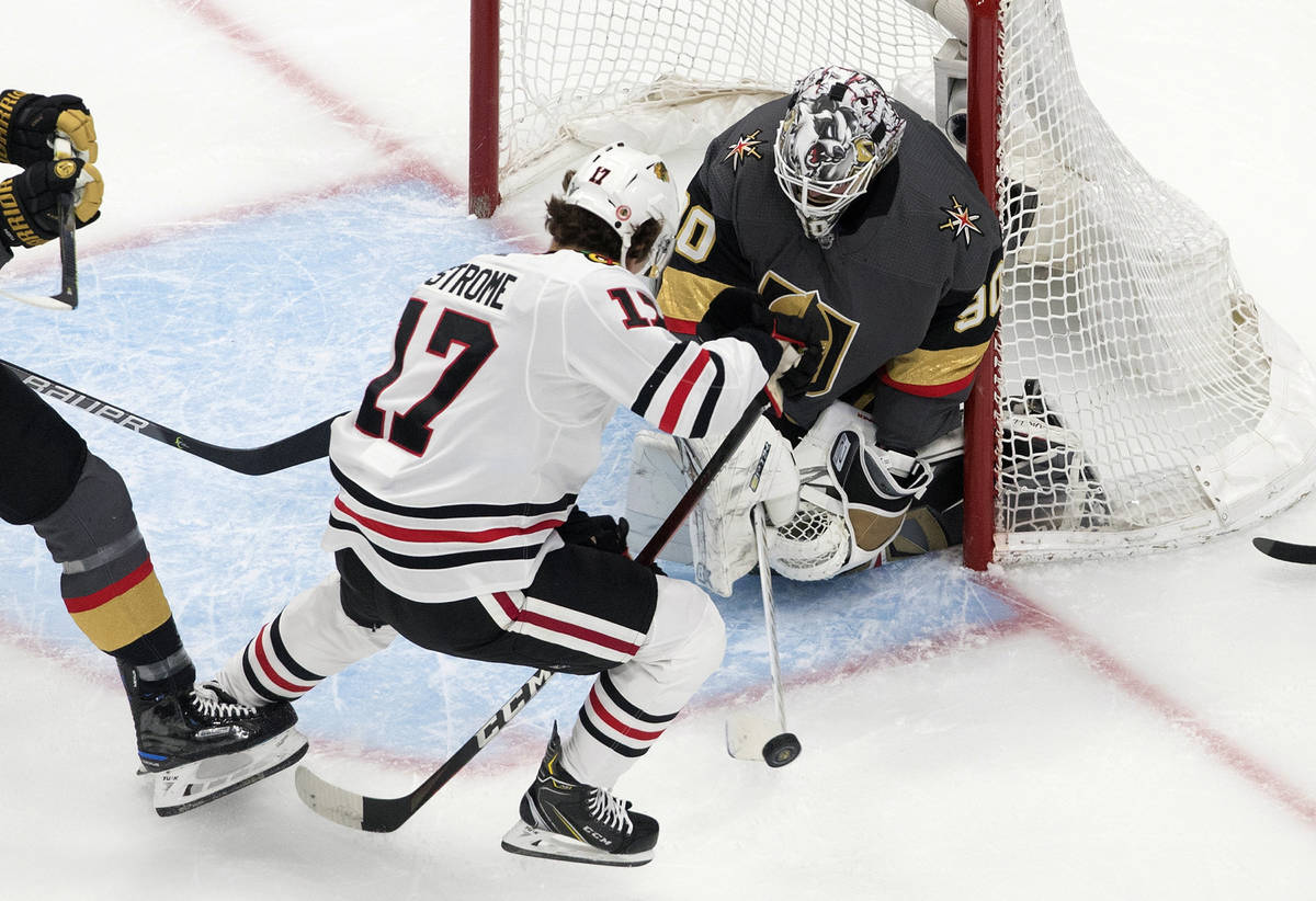 Vegas Golden Knights goalie Robin Lehner (90) makes the save against Chicago Blackhawks' Dylan ...