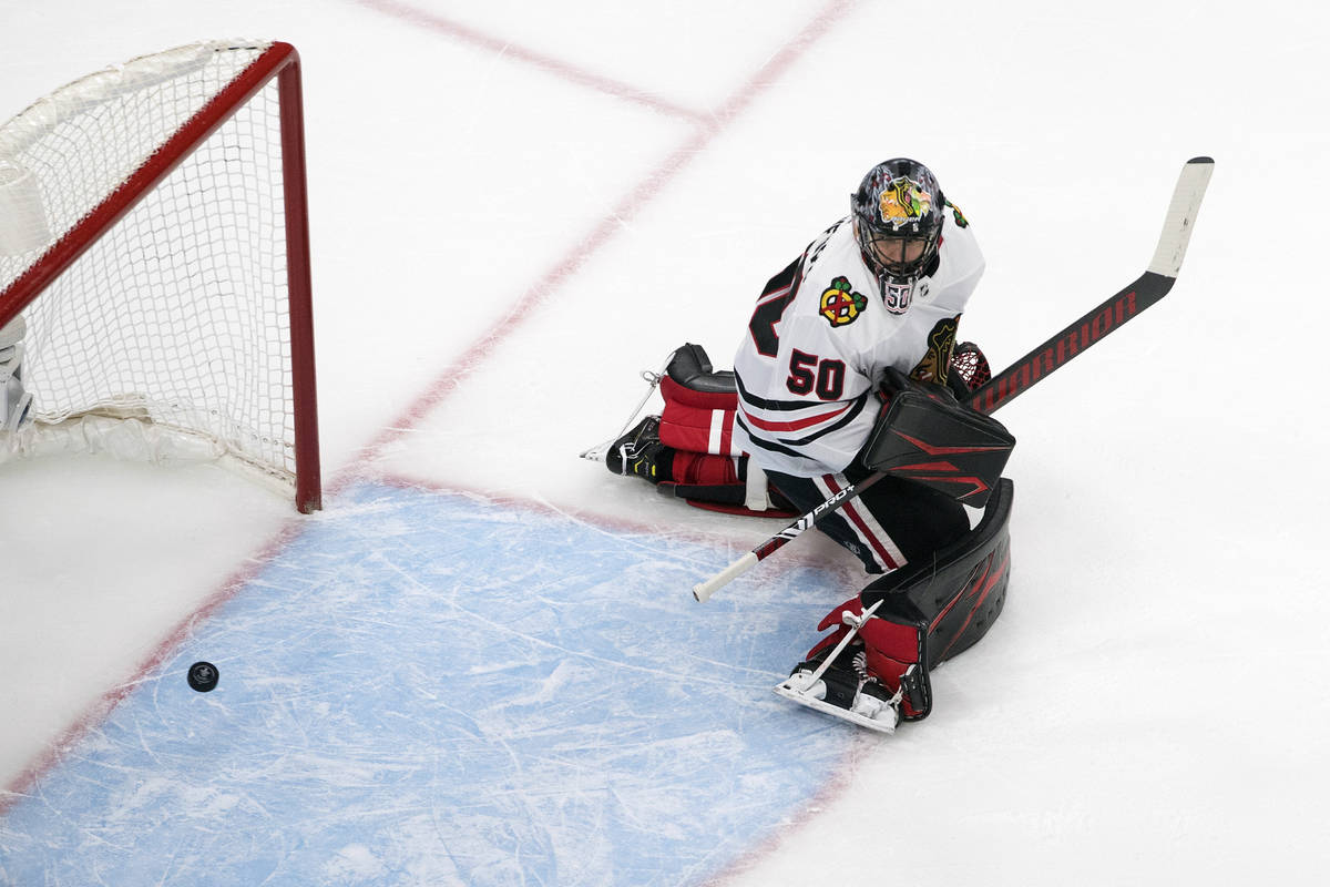 Chicago Blackhawks goalie Corey Crawford (50) is scored against by the Vegas Golden Knights dur ...