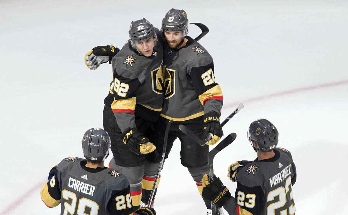 Vegas Golden Knights' Tomas Nosek (92), Shea Theodore (27), William Carrier (28) and Alec Marti ...