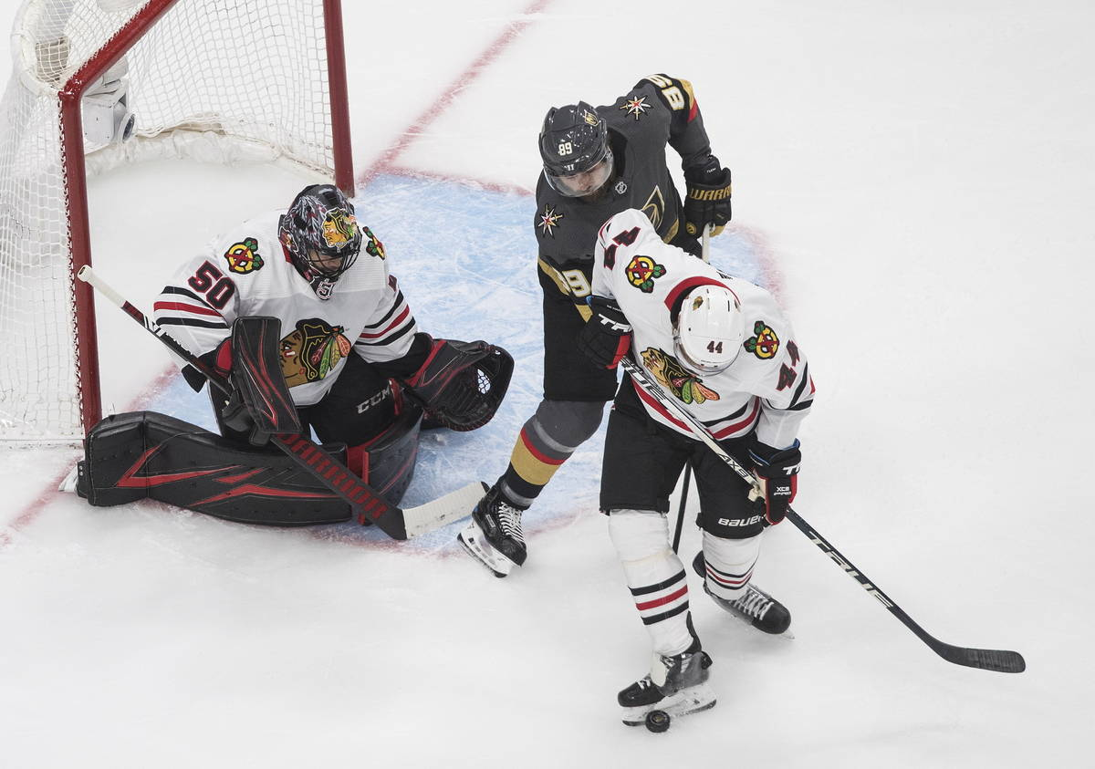 Vegas Golden Knights' Alex Tuch (89) and Chicago Blackhawks' Calvin de Haan (44) battle as Blac ...