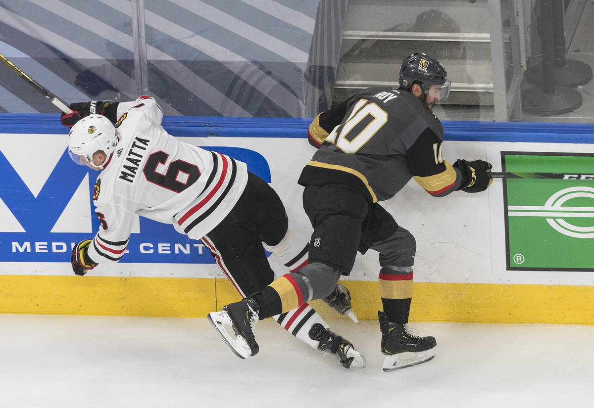 Vegas Golden Knights' Nicolas Roy (10) checks Chicago Blackhawks' Olli Maatta (6) during the fi ...