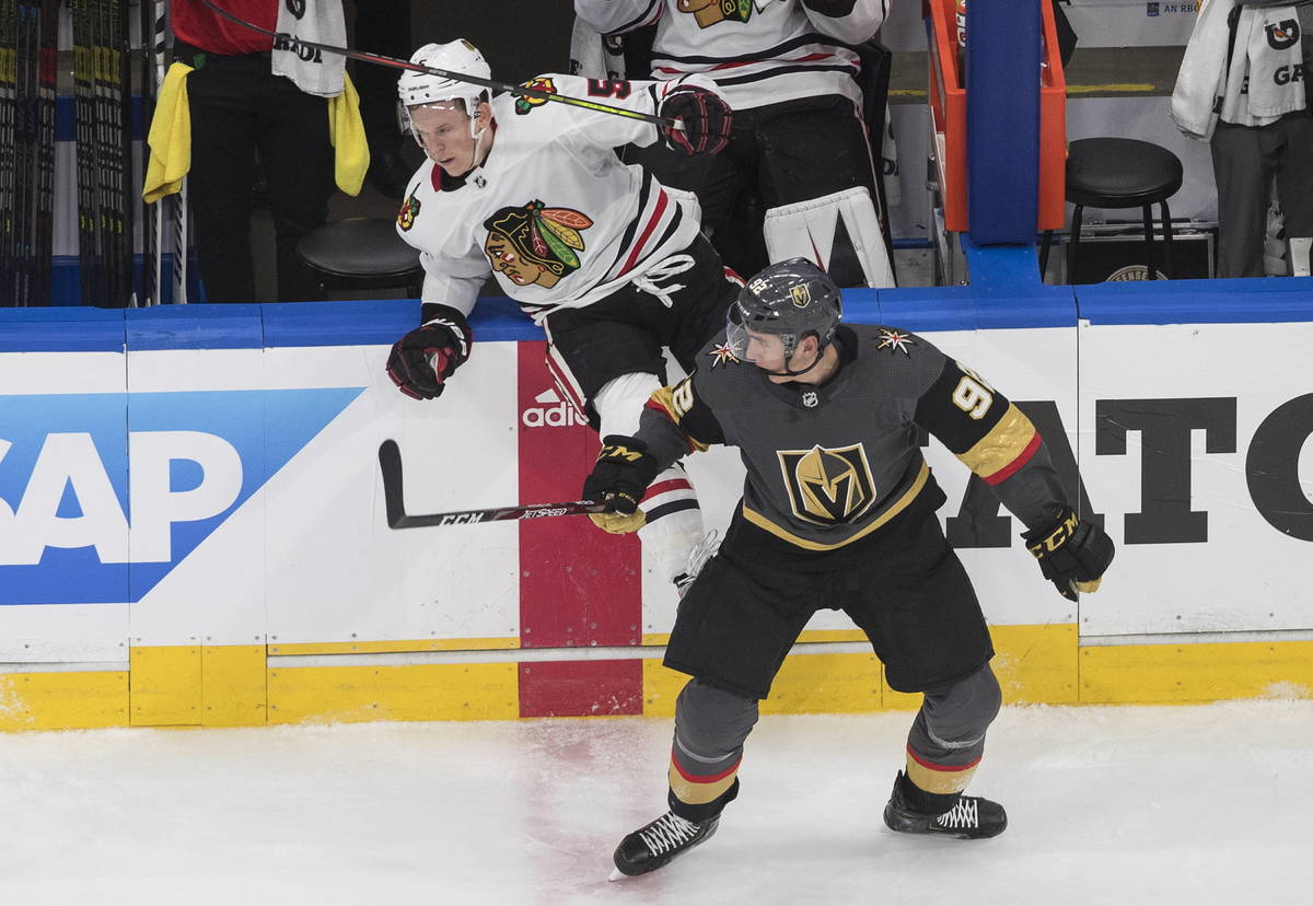 Vegas Golden Knights' Tomas Nosek (92) checks Chicago Blackhawks' Connor Murphy (5) during the ...