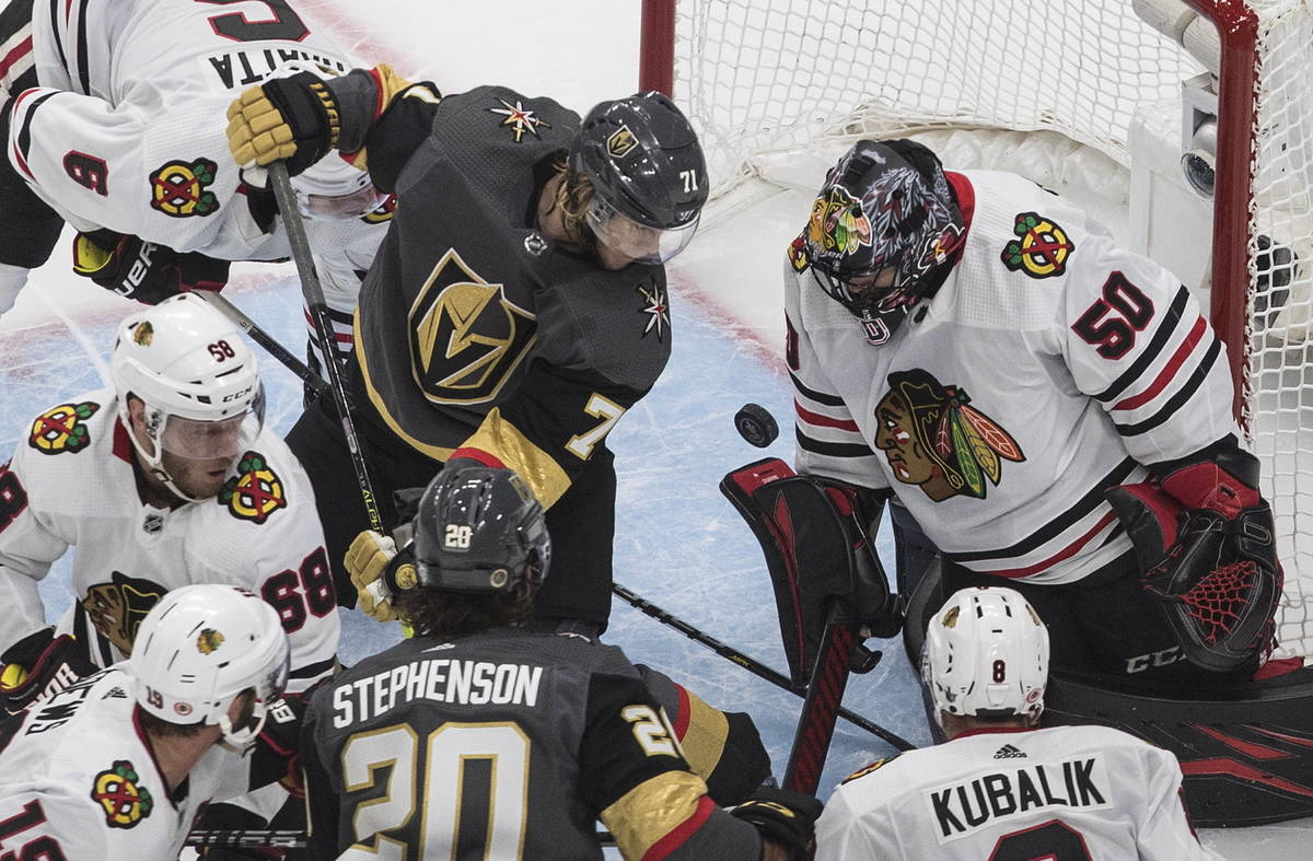Vegas Golden Knights' William Karlsson (71) is stopped by Chicago Blackhawks goalie Corey Crawf ...
