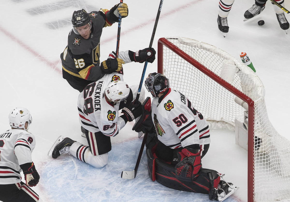 Vegas Golden Knights' Paul Stastny (26) and Chicago Blackhawks' Slater Koekkoek (68) battle in ...