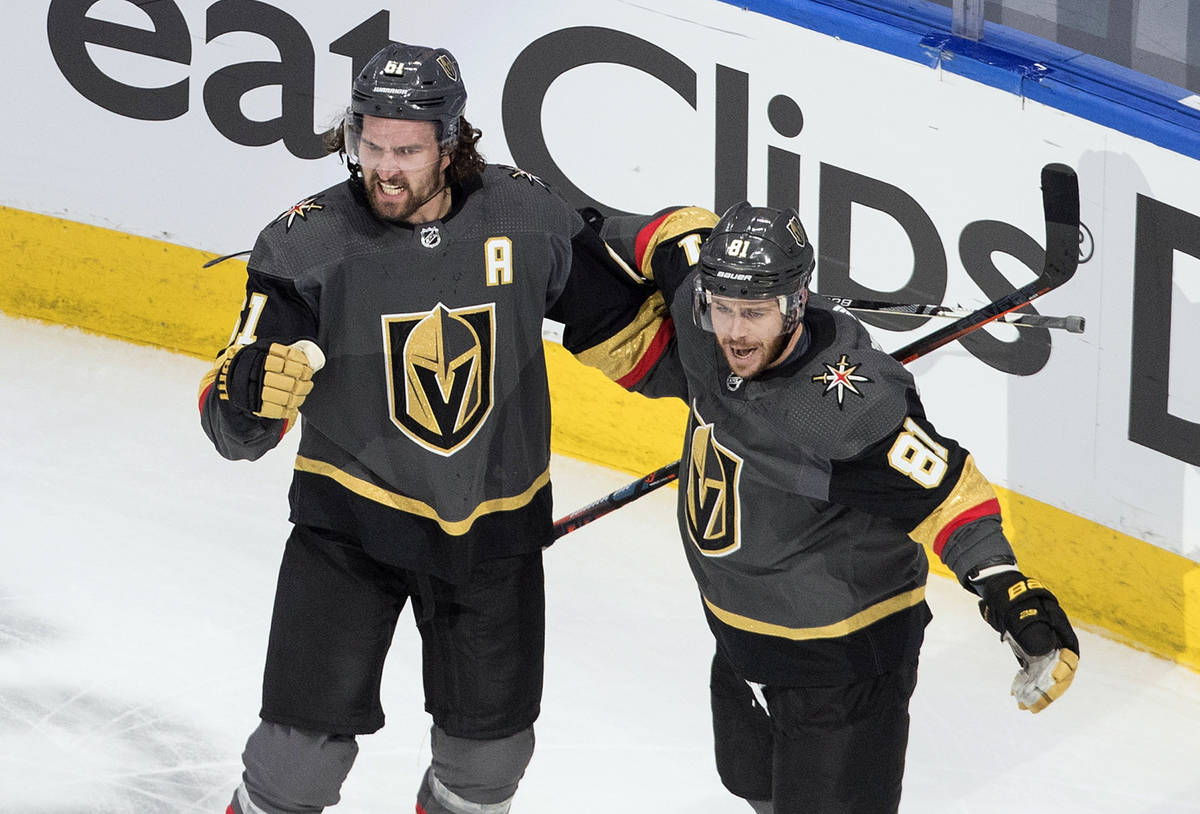 Vegas Golden Knights' Mark Stone (61) and Jonathan Marchessault (81) celebrate a goal against t ...
