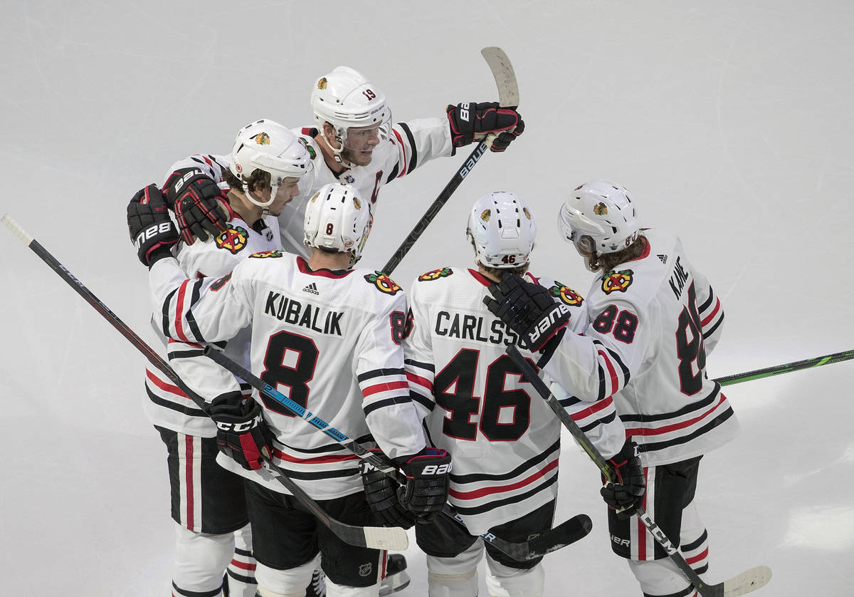 Chicago Blackhawks players celebrate a goal against the Vegas Golden Knights during the second ...