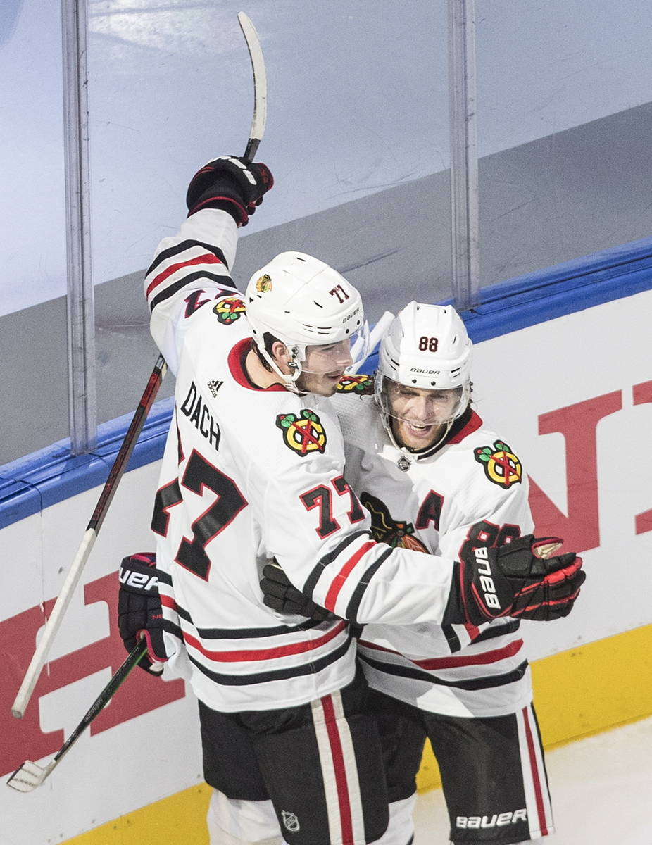 Chicago Blackhawks' Kirby Dach (77) and Patrick Kane (88) celebrate a goal against the Vegas Go ...