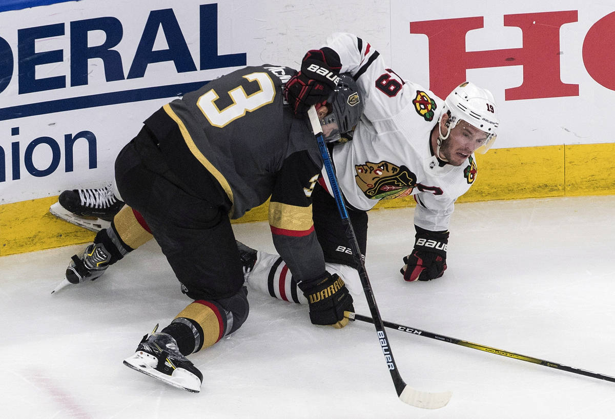 Vegas Golden Knights' Brayden McNabb (3) and Chicago Blackhawks' Jonathan Toews (19) battle dur ...