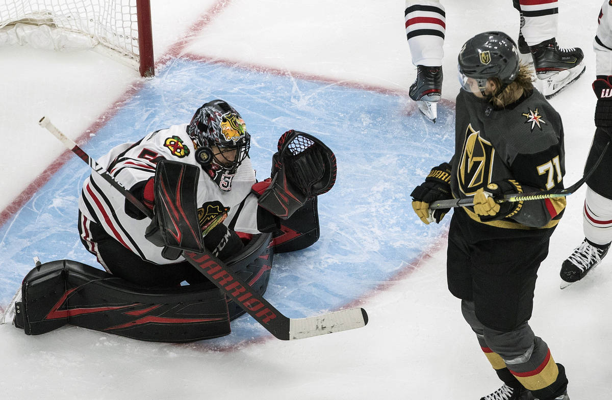 Vegas Golden Knights' William Karlsson (71)watches as Chicago Blackhawks goalie Corey Crawford ...