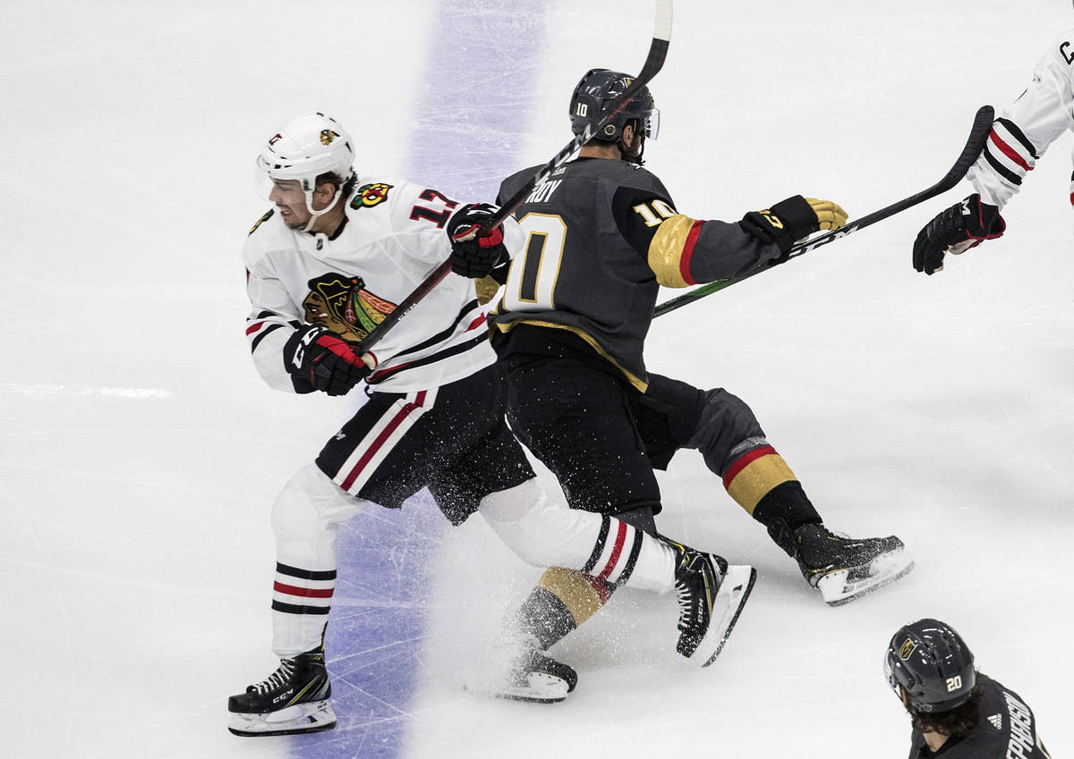 Vegas Golden Knights' Nicolas Roy (10) and Chicago Blackhawks' Dylan Strome (17) collide during ...