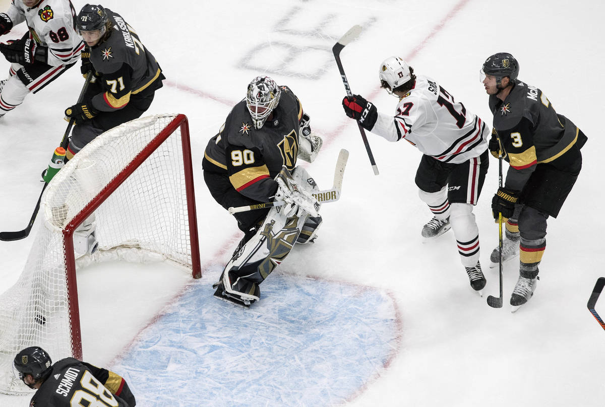 Vegas Golden Knights goalie Robin Lehner (90) is scored on by Chicago Blackhawks' Dylan Strome ...