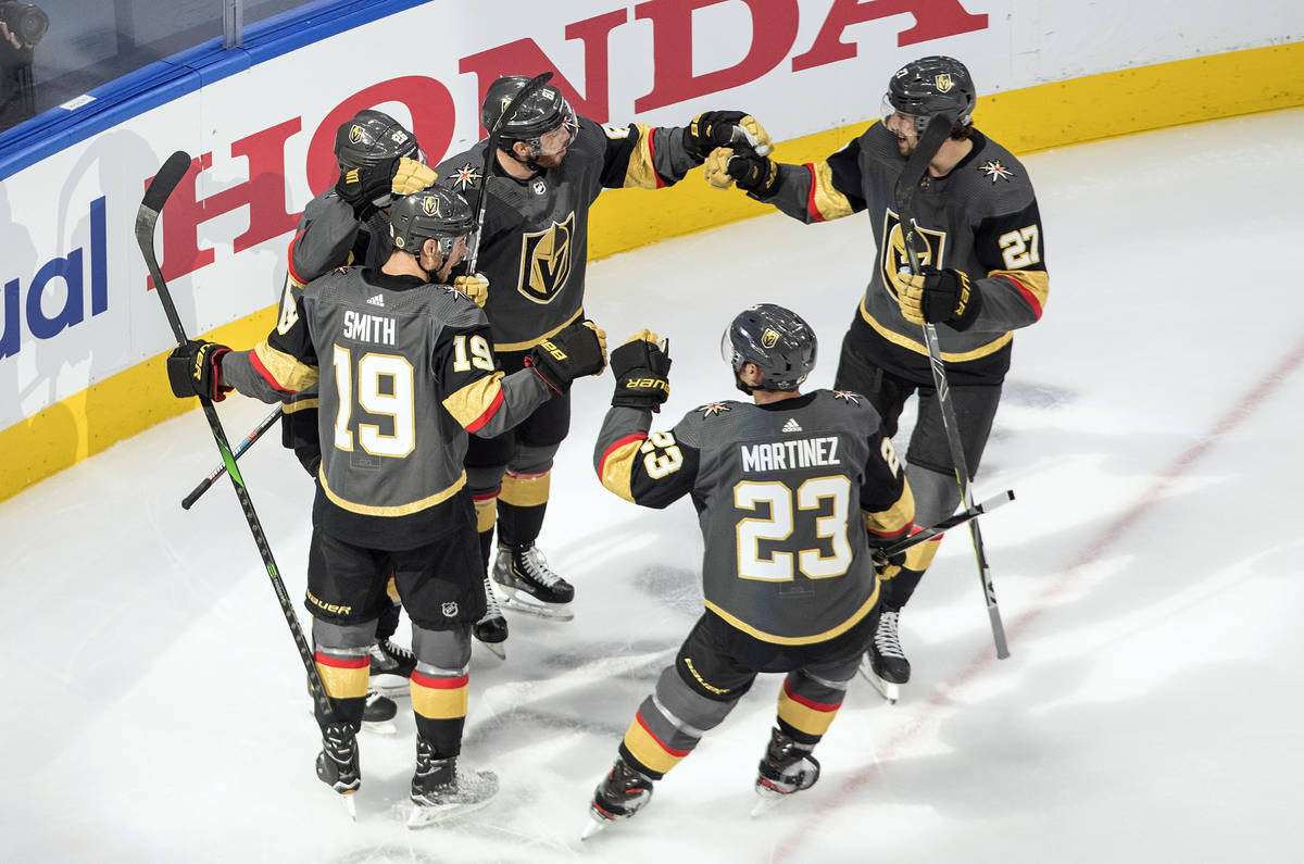 Vegas Golden Knights players celebrate a goal against the Chicago Blackhawks during the first p ...