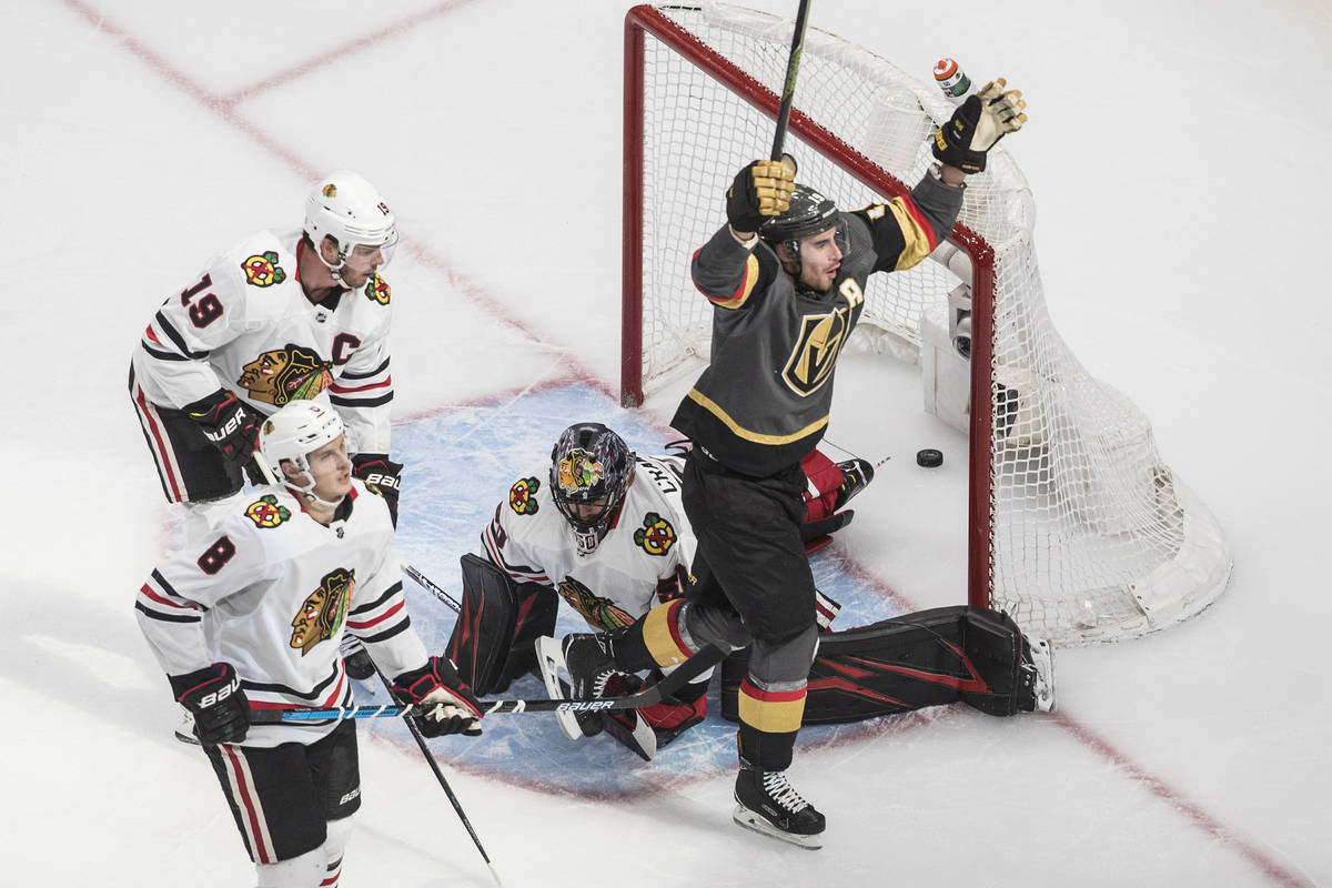 Vegas Golden Knights' Reilly Smith (19) scores on Chicago Blackhawks goalie Corey Crawford (50) ...