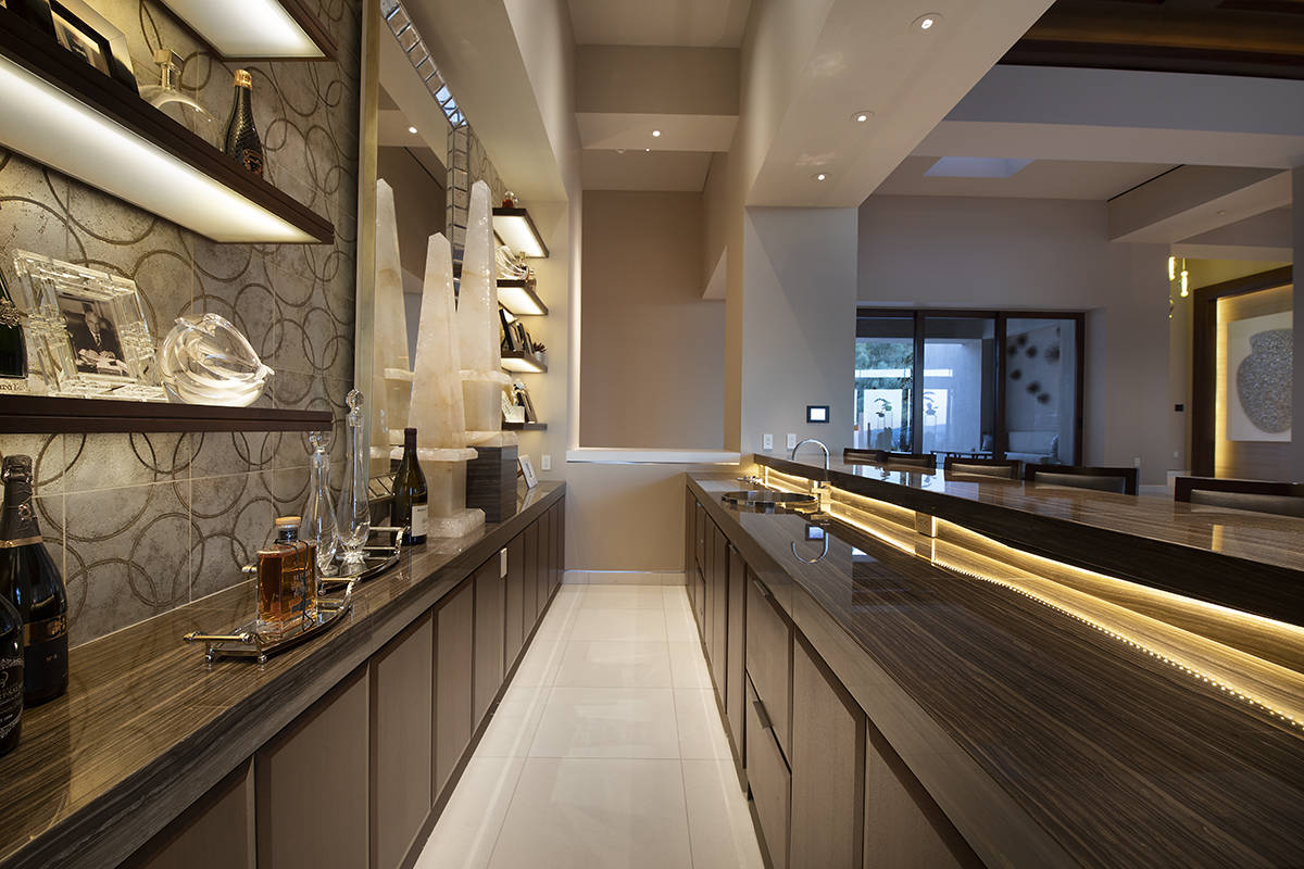 The home has several bars in different entertainment areas. (Synergy Sotheby's International ...
