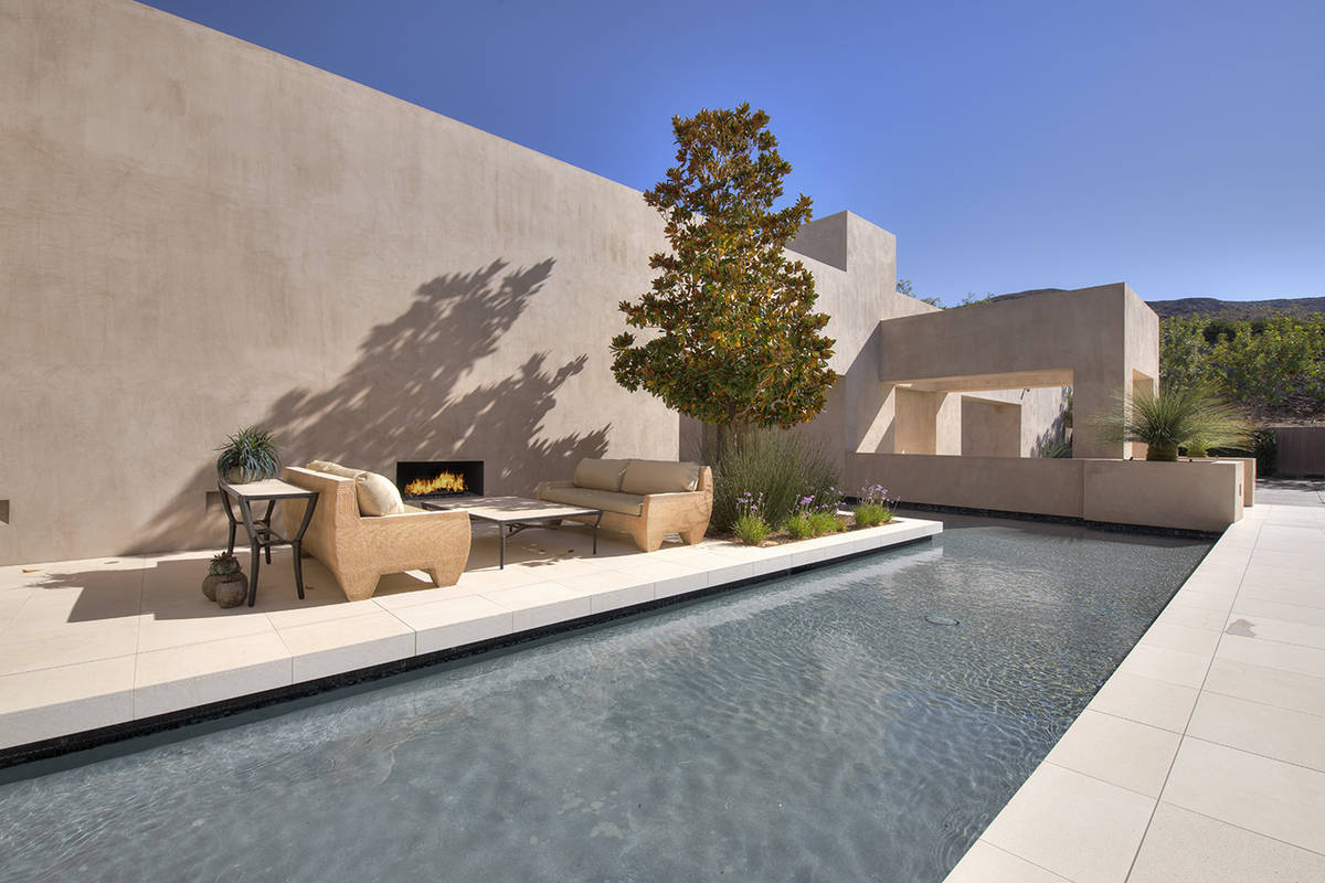 A water feature is at the front of the home. (Synergy Sotheby's International Realty)